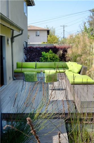 Bold colors for cushions and furnishings are perfectly on-trend and help a small space feel well-designed. Learn more tips for dealing with a small space here: http://www.landscapingnetwork.com/landscaping-ideas/small-yard/
