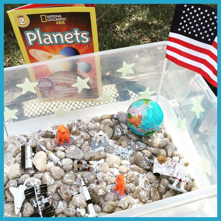 Astronaut sensory bin: rock vase filler (moon rocks), flour (moon dust), Space Toob toys, Earth ball, Anerican flag, glow-in-the-dark stars, and star confetti.