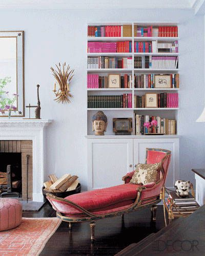 Candace Bushnell's Living Room In the Sex and the City author's Greenwich Village apartment, decorated by Susan Forristal, a hot-pink, 19th-century Venetian chaise longue adds a dose of drama to a corner of the living room; the vintage gold-leafed sheaf sconce is one of a pair flanking the mantel, which is original to the apartment.