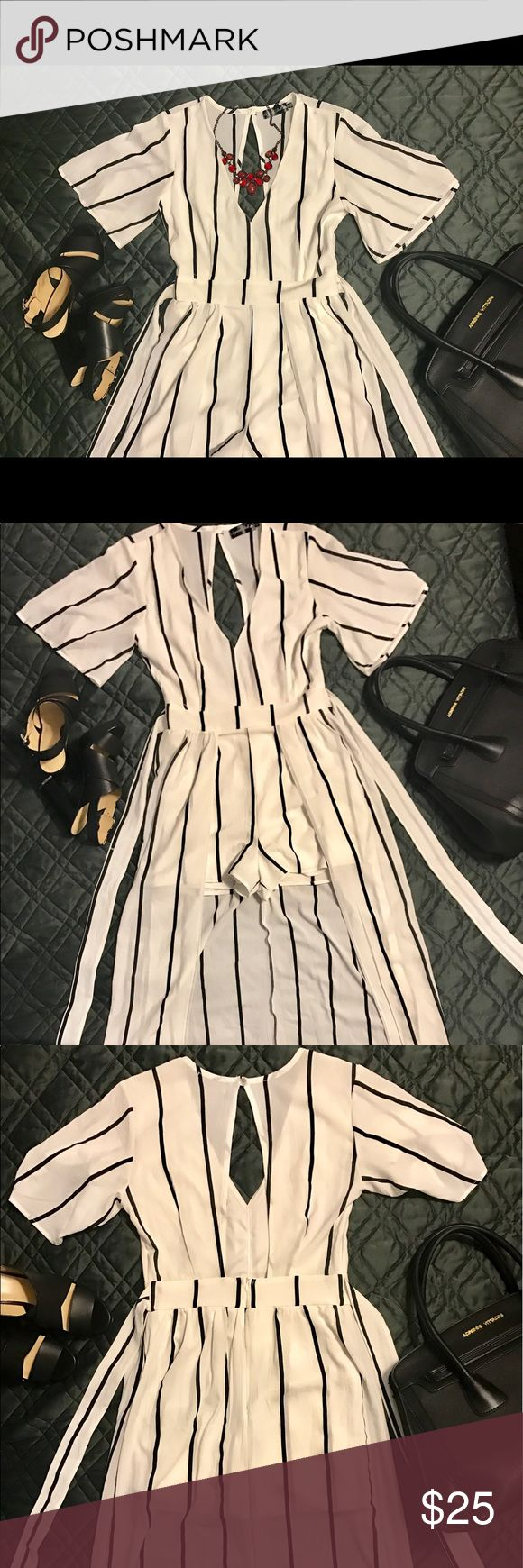 """Crystal Doll Romper with Train What is white and black with a """"I am a princess"""" feeling all over? THIS! Such a beautiful romper with a small train to blow in the wind. We had family pictures taken and it was the absolute best decision I had made to wear this! Perfect shape. Crystal Doll Dresses"""