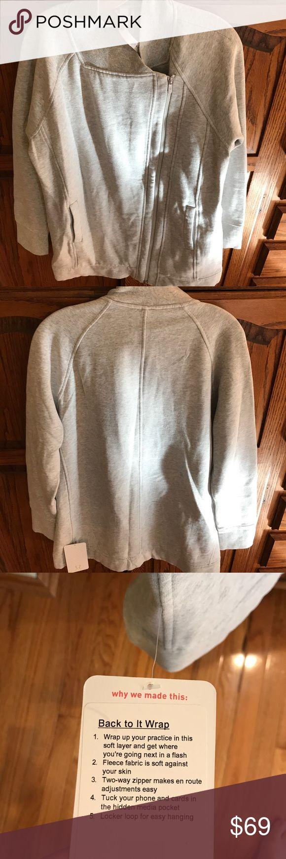 Nwt lululemon back to it wrap Nwt lululemon back to it wrap size 10 light grey color code hvpr lululemon athletica Jackets & Coats
