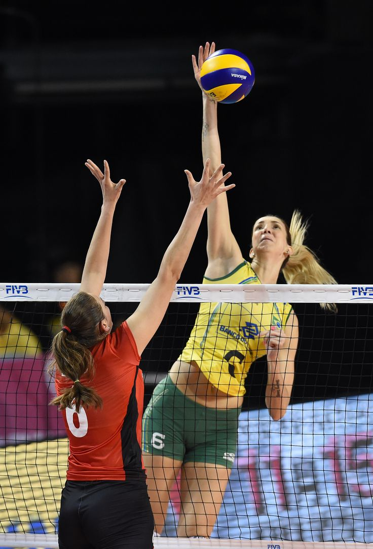 Thaisa Menezes Of Brazil Spikes The Ball Against Belgium Female Volleyball Players Women Volleyball Olympic Volleyball