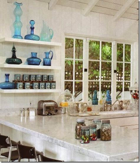 I love blue glassware on window shelves.  Once saw a small lake cottage that's front porch was all glass shelves in the windows full of dark blue glassware.  WANTED -- CRYED!!!