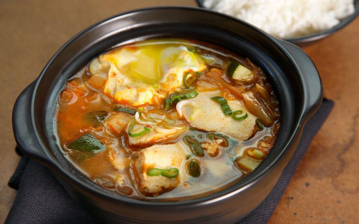 This Korean kimchi tofu soup recipe creates a spicy broth that infuses custardy tofu with complex flavors and spices.