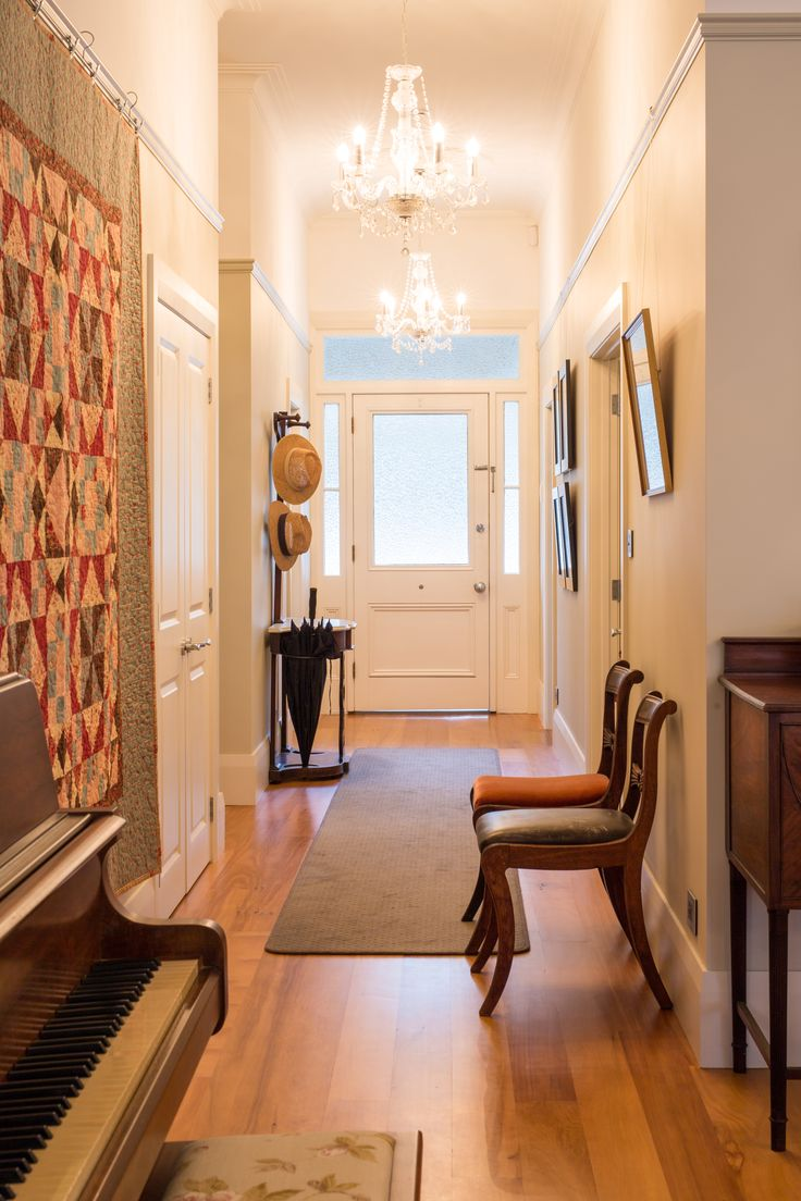 :: Cambridge Villa :: Renovated hallway featuring beautifully detailed ceiling roses with chandeliers