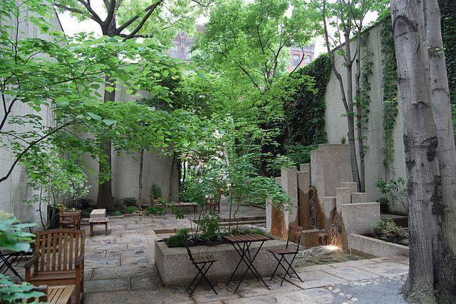John F. Collins Pocket Park Lovely dappled light in lush green garden