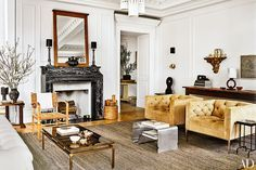 Nate Berkus and Jeremiah Brent Share Their New York City Apartment and Daughter Poppy's Nursery Photos | Architectural Digest ; mustard color chairs