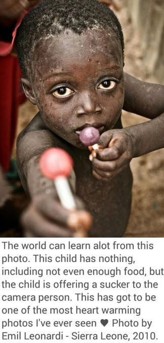"""This is an image of and African child in poverty giving candy to a cameraman.  What this image means to me is that as a society we should be more supportive of each other and share more. The image represents a message that says """"if a child that has nothing is still willing to give, then why can't we?""""  The image motivates me because I look at this as a message to me, that someone always sees when a good deed is delivered. And it makes me want to be more caring of others."""