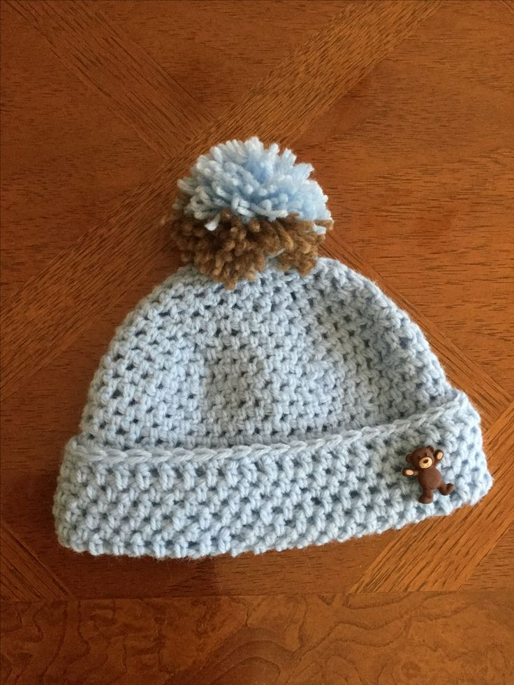 The two tone brown and blue Pom Pom is the perfect way to energize this blue beanie while designing a hat to keep warm in cold weather.  For many more photos and ideas, see:  http://www.lilcreates.com/lillians-bllog/energize-your-crocheted-beanie-with-a-playful-beanie