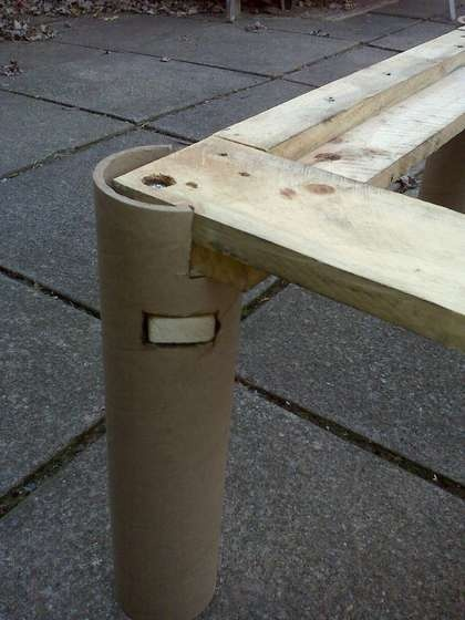 use sturdy cardboard tubes as the legs of a footstool or coffee table