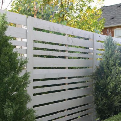Horizontal slat fence differing widths