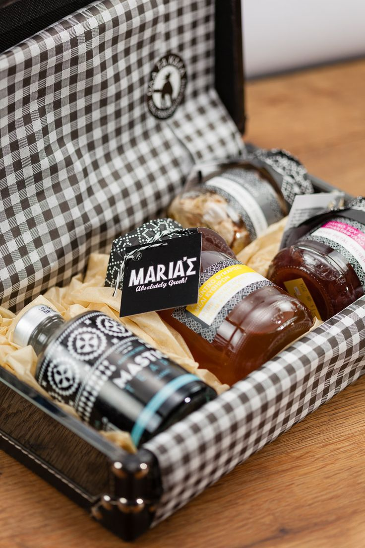 Luxurious small suitcase coated with antique style mirror and beautiful leather details, containing traditional liqueur Mastic Tears 200ml, grilled white cheese (manouri), rose petals sweetpreserv...