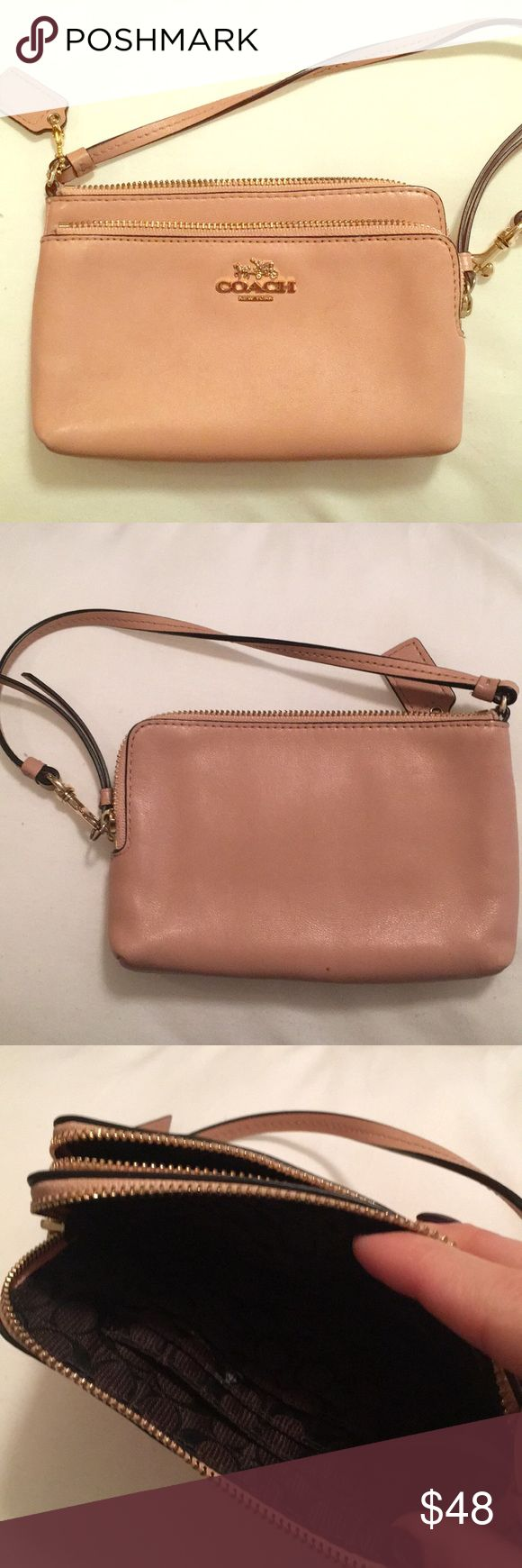 Coach clutch Used Coach clutch! Light pinkish roseish nude color. Normal wear. Leather. Few scratches on leather and inside is clean minus one mark shown in photos Coach Bags Clutches & Wristlets