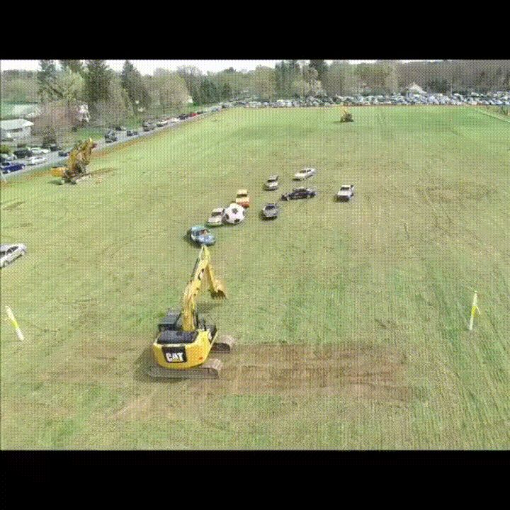Excavator Playing Goalie in Giant Soccer Game GIF by Jon - Excavator playing goalie in giant soccer game GIF.https://s3-us-west-1.amazonaws.com/h...tor_soccer.gif