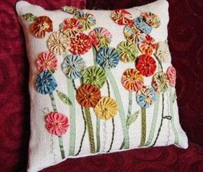 Cute yo-yo flower pillow.