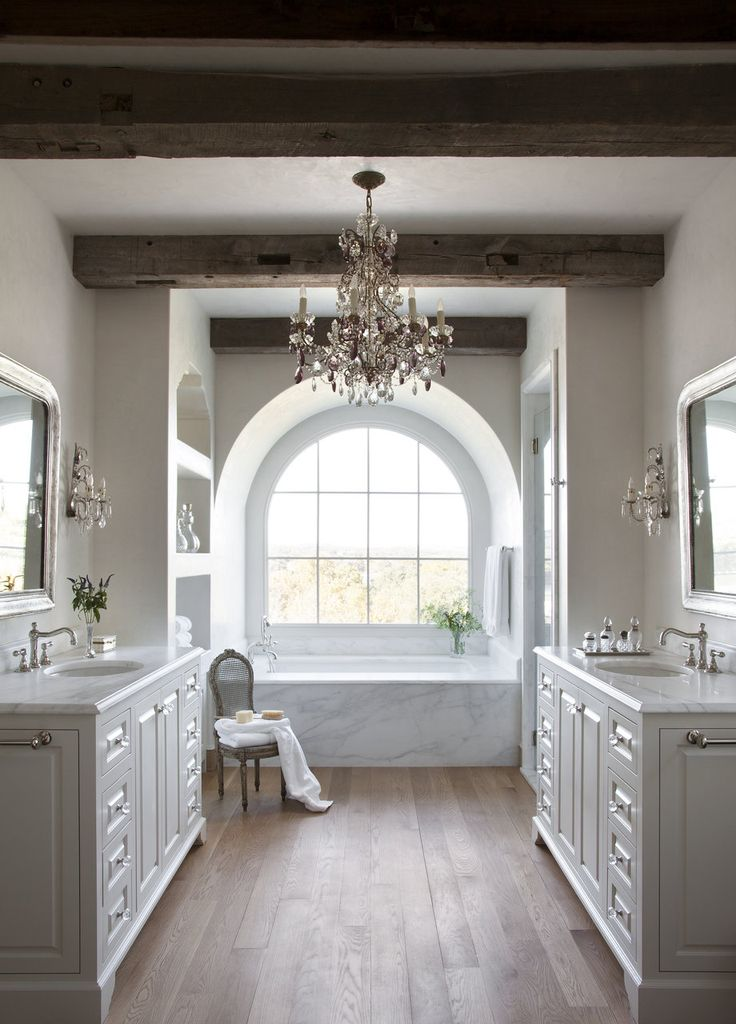 Like the rustic beams combined with a chandelier dream bathroom // Ryan  Street & Associates