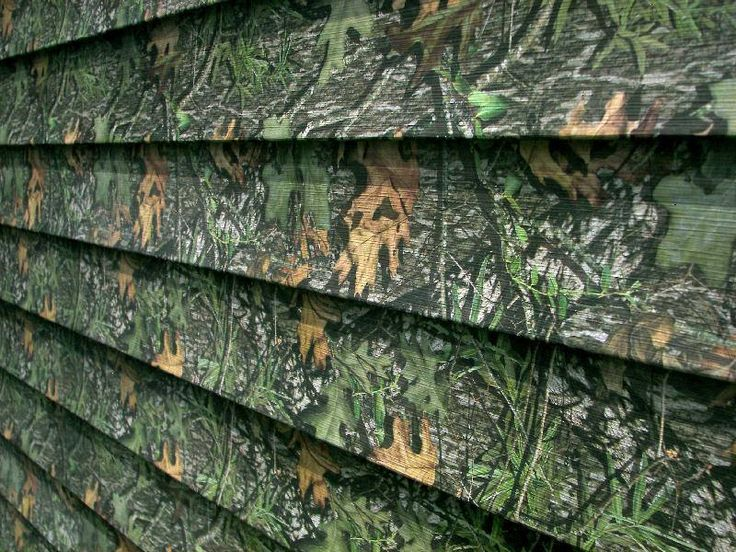 Camo vinyl siding!!! Coolest thing ever for hunting lodge or deer stands.