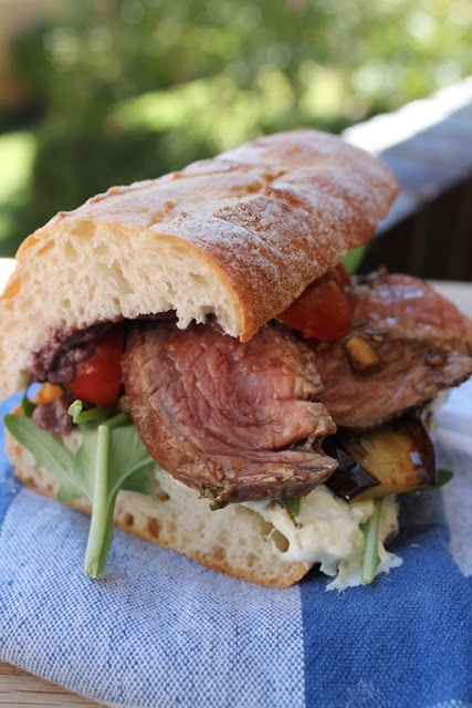 The Ultimate Mediterranean Steak Roll: Rest grilled rump/fillet steak slices in mix of 1 Tbls bals vinegar, 1/2 c crushed garlic clove; dash olive oil. Butter halved ciabatta. Bit of olive tapenade on 1 half topped with baby tomatoes - other half with tzatziki, rocket & grilled aubergine. Top with steak slices & enjoy!