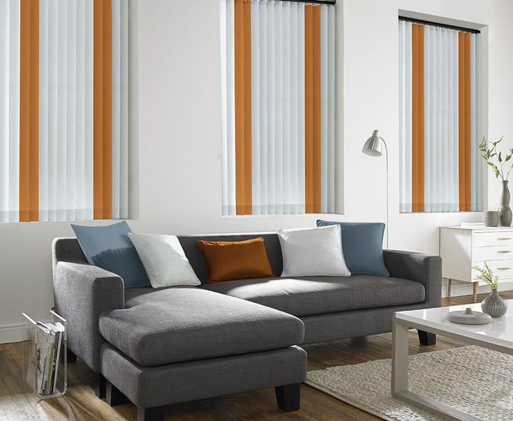 These white & orange Vertical blinds are available in different forms including: wood, lace, aluminium, rigid and fabric. Probably the most practical blind type can be used on curved and sloping windows. Vertical blinds offer precise control of sun and light. They can be machine washable and are very versatile. Whether it's classical, modern, comfort or cutting edge design you want, the choice is yours at Bolton Blinds.