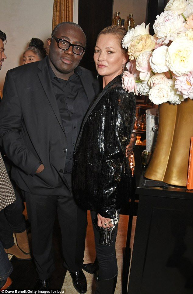 Man of the hour: Kate was also seen posing with British Vogue Editor Edward Enninful, celebrating his first issue as Editor