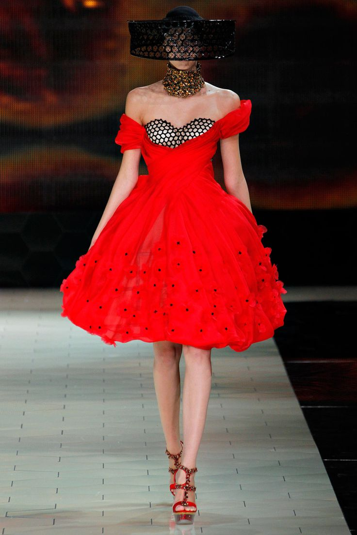 Short, red ball gown  with the honey comb detailing in the bodice and the 3-D flower embellishment in the skirt--fierce!  Alexander McQueen