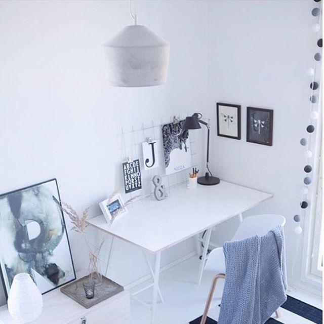 Minimalist concrete lamp in a Scandinavian workroom.
