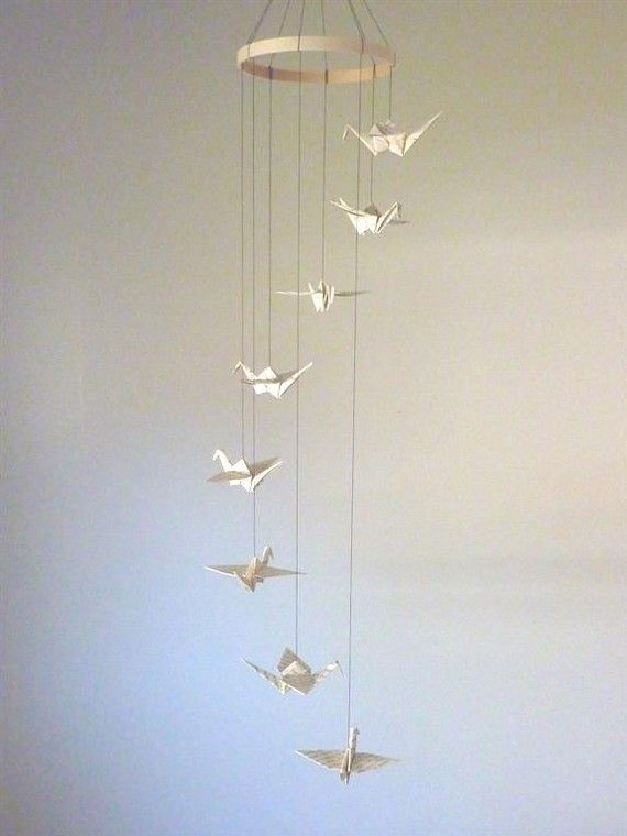 Crane mobile made from old book paper.    http://www.etsy.com/listing/62890252/on-sale-20-off-origami-crane-mobile