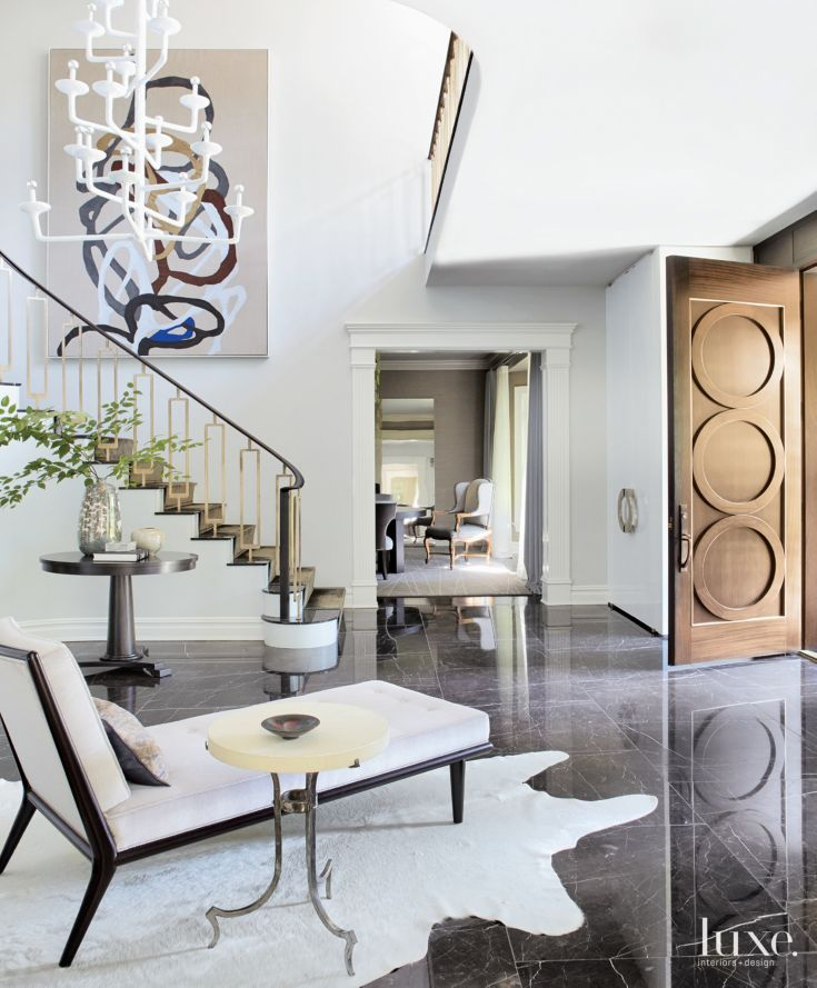 To set the mood for and provide a focal point in each space, the designer brought in tricked-out and overstated chandeliers, pendants and sconces for each room.