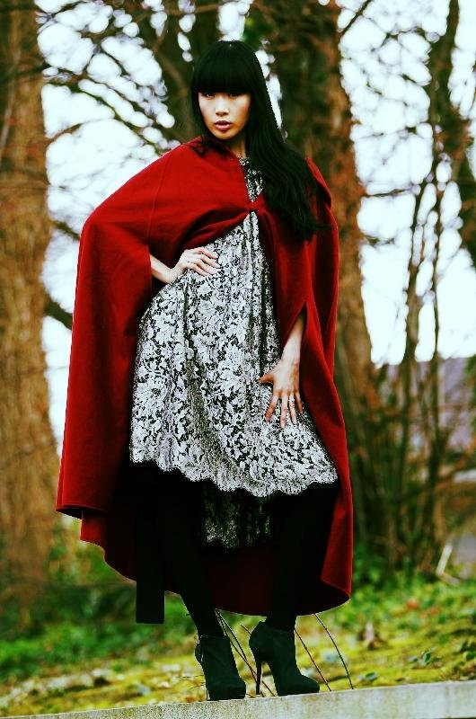Yomiko Chen wearing a Queen Maeve cape in wool and cashmere with velvet lined hood (€230) by Siobhan Wear and a Metallic silver lace and silk dress (€1100) by Eilis Boyle