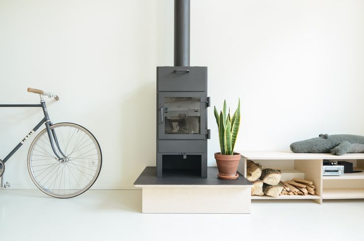 """The open-plan living room is Standard Studio architect and creative director Jurjen van Hulzen's favorite part of the home. """"Mom can cook, Dad can work or play piano, the kids can play. At nighttime there's a fireplace and a nice sitting area,"""" says van Hulzen. """"It really just has a super nice energy."""""""