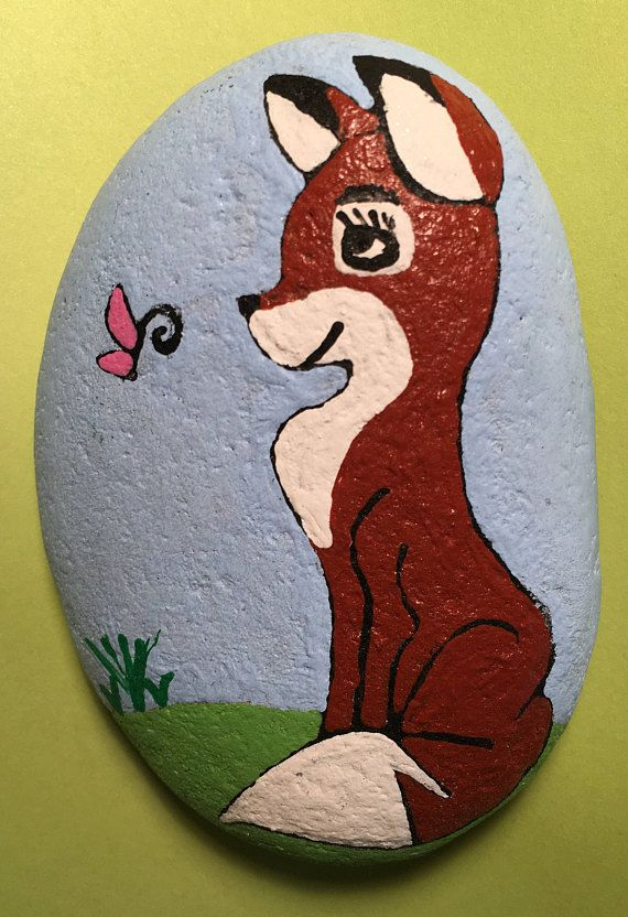 This listing is for a hand painted river rock of a fox very cute.All rocks are painted with Acrylic paint and sprayed with a protective coat. All items ship within two days of payment. Any further questions please feel free to ask. Custom orders are available. Thank you for looking and