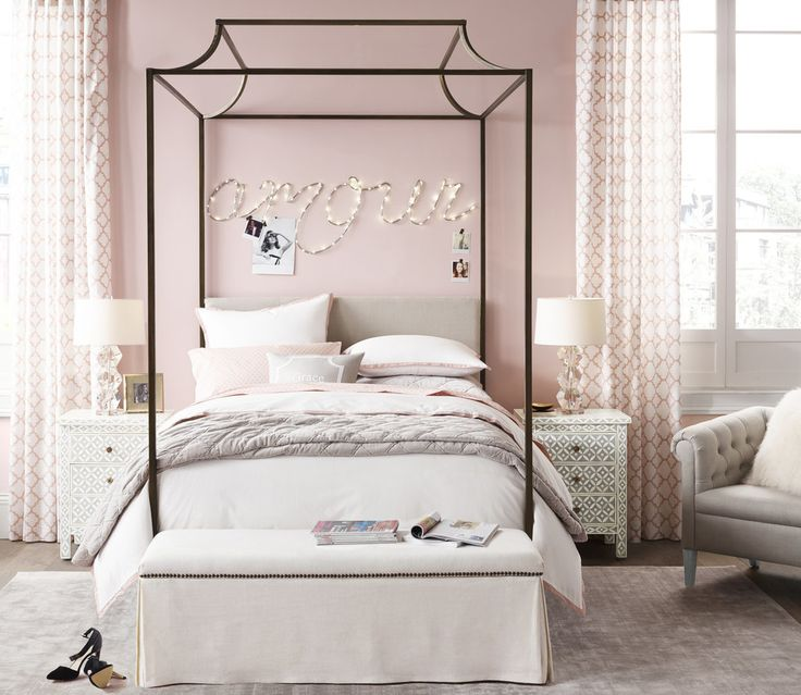 We love the clean lines of the Cecily Canopy Bed (from $1,099). Image Source: Restoration Hardware