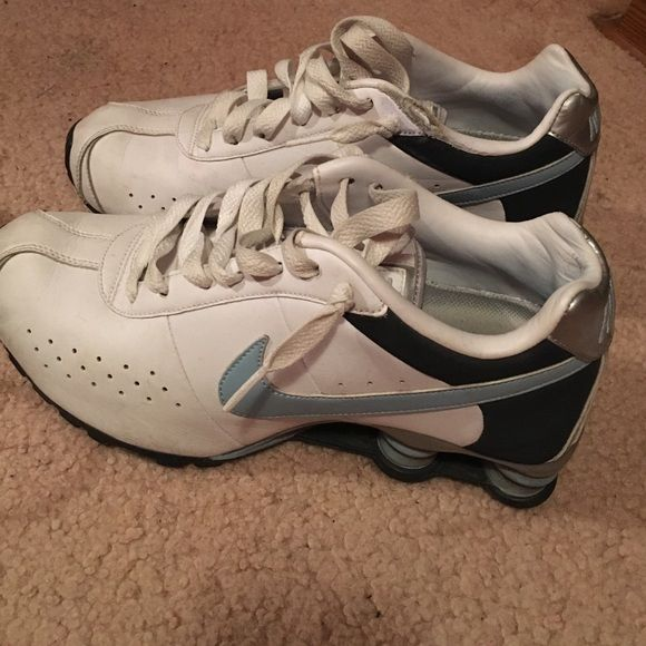 Nike shock sneakers White with blue nike sign sneakers. In decent shape for how much they were worn. Major scuffs mark are shown. Size 7 and a half Nike Shoes Sneakers