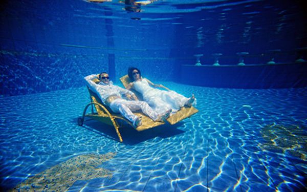 Bride and groom relaxing in a swimming pool
