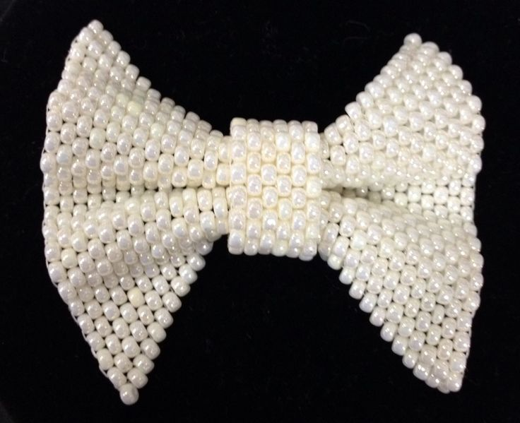 A beaded bow for your wedding designs!   www.thebead.co.uk