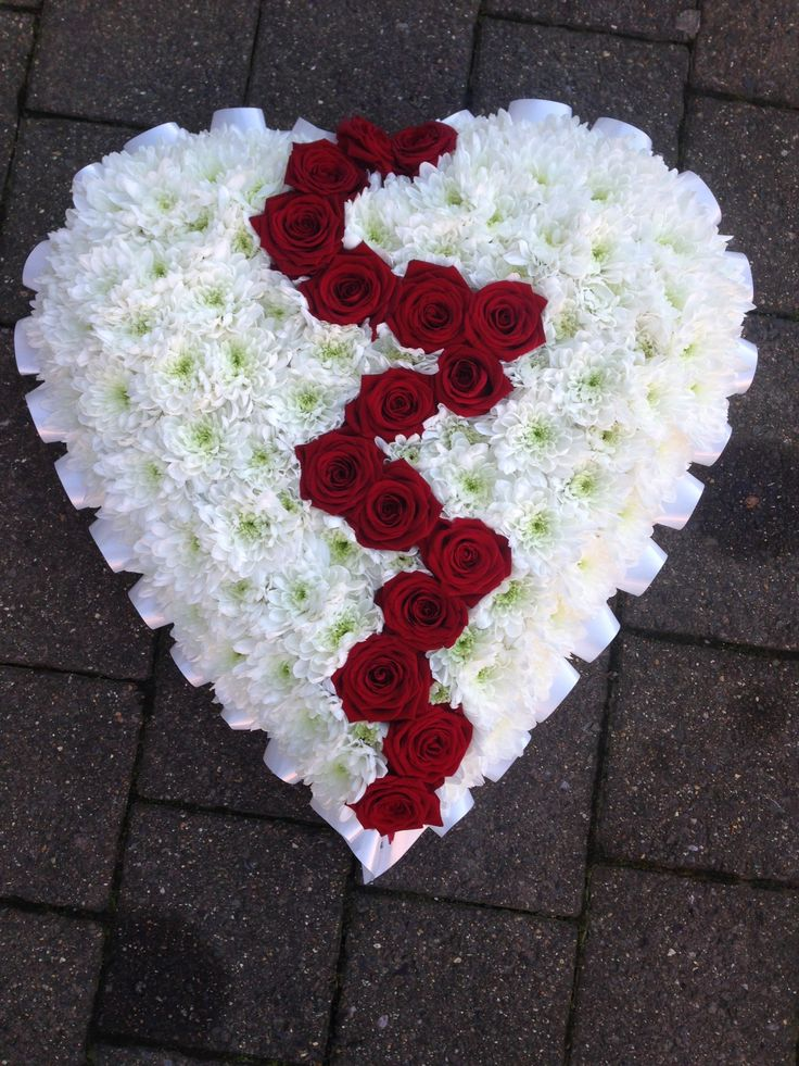 Broken heart funeral tribute with red roses