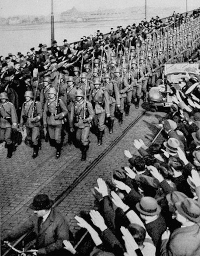On this day, March 7th, 1936, Nazi leader Adolf Hitler violates the Treaty of Versailles and the Locarno Pact by sending German military forces into the Rhineland, a demilitarized zone along the Rhine River in western Germany. This marks the beginning of the Nazi nightmare that swept Europe.