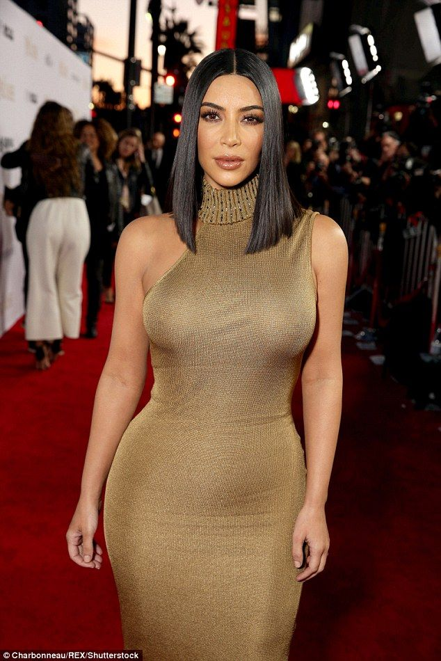 Kim Kardashian wows in skintight gold dress at The Promise premiere #dailymail