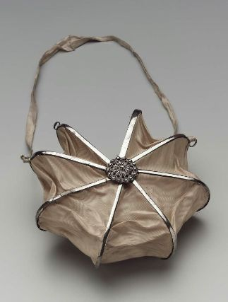 Heptagonal bag. French, about 1800. Old rose moiré silk panels on steel cockade frame. Cut steel rosettes at rivets.