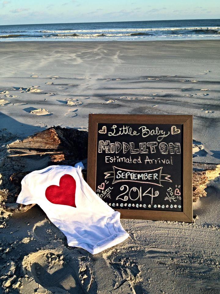 Pregnancy announcement on beach
