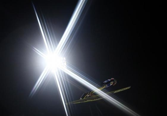 Simon Ammann of Switzerland soars through the air during his qualification jump for the fourth event of the 61st four-hills ski jumping tournament in Bischofshofen, January 5, 2013. REUTERS- Dominic Ebenbichler