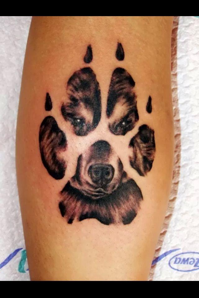 Dog in paw print tattoo