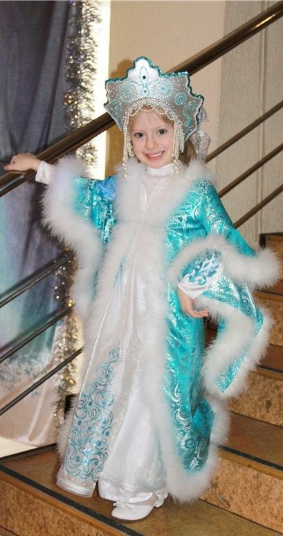 A smiling Russian girl in national festive outfit on the occasion of winter…