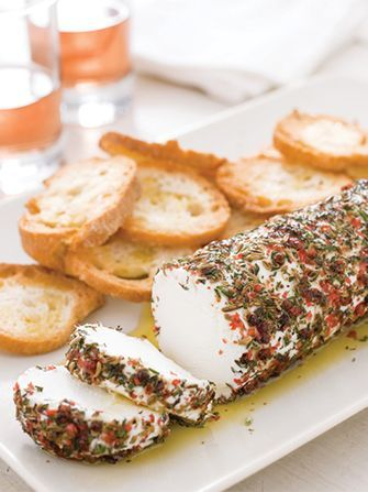 Save this easy holiday make-ahead appetizer recipe to serve Goat Cheese with Pink Peppercorns + Herbs for your Christmas party.