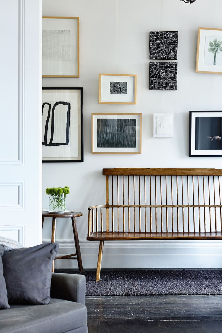 "The bright white walls in the hallway are the ideal backdrop for artworks by (clockwise from top left) Kitty Kantila, Jimmy Pike, Dorothy Napangardi, Sidney Nolan, Sophia Szilagyi, Le Corbusier, Cy Twombly and Rover Thomas.  **Bench** and **side table** by [Greg Stirling](http://gregstirlingfurniture.com?utm_campaign=supplier/|target=""_blank""). **Runner** from [Armadillo&Co](http://armadillo-co.com?utm_campaign=supplier/