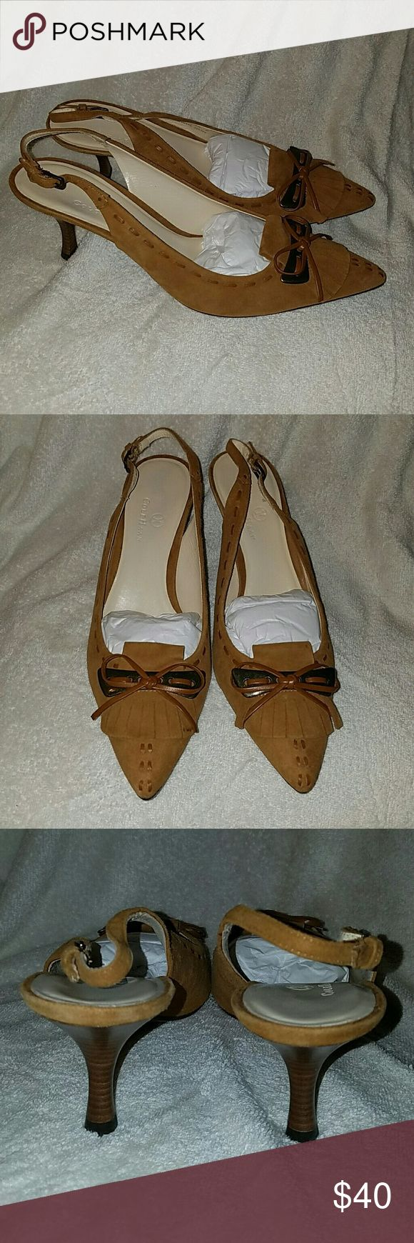 """Cole Haan tan suede sling back heels size 9.5 This is a beautiful pair of Cole Haan tan suede slingback heels.  Stored in plastic with original tissue in toe. They have a great wooden High kitten style heel that measures about 2 3/4"""".  These shoes were never worn  The toes are pointed and the top of the shoe is adorned with fringe and a leather bow.  There is a leather stitching around the shoe and down the shoe. Very well-made. Made in Brazil. Size 9.5 Please contact me for any further…"""