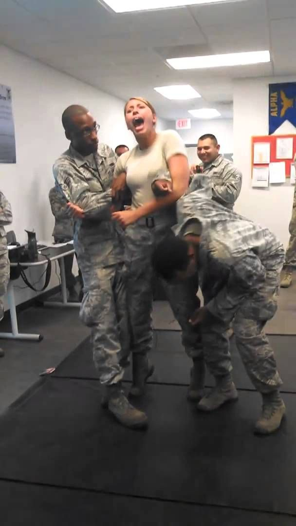 US Air Force Girl gets tazed and has interesting reactionary response...poor guy!