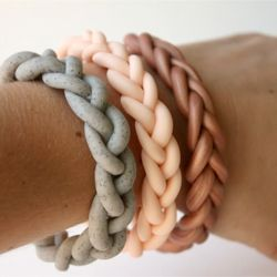 Braided polymer clay bracelets! These were fun and easy. Just be sure to secure the ends together as well as you can and bake a little longer than the package calls for. If you don't, they will break apart at the seam.