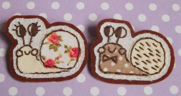 Embroidered snail brooches