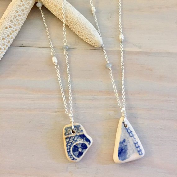 These gorgeous sea pottery necklaces are each unique and one of a kind! They each feature a genuine sea pottery pendant collected from beaches around the world, and are finished off with a silver plated chain. The beaded chain option is accented with alternating freshwater pearls and glass beads, and are both chain styles are finished off with nickle-free silver plated findings. *Please see the third and fourth pictures to choose your pendant! Note that the first picture uses a US...